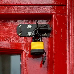 secure (Harry Halibut) Tags: road door red yellow sheffield padlock allrightsreserved grocers londond colorphotoaward polonium redsheff andrewpettigrew