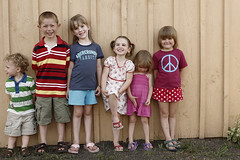 the line up (Orrin) Tags: girls cute boys wall kids barn children colorful little sandals topv1111 small young lineup