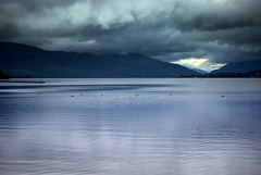 Storm clouds gather (10000 wishes) Tags: blue sky lake storm water clouds scotland nikon ducks lochlomond stormclouds luss superbmasterpiece d40x platinumheartaward