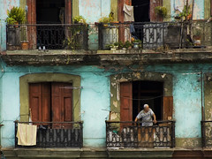 Greet the new day (steverichard) Tags: life door morning man window photo casa shoes apartment image decay balcony havana cuba centro sneakers trainers human laundry railing lahabana spanishcolonialarchitecture steverichard