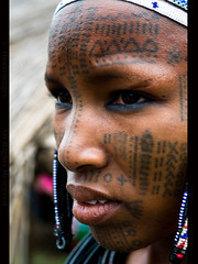 BENIN (BoazImages) Tags: life africa portrait woman black girl face tattoo documentary tribal benin tribe ethnic facial indigenous fulani tattooed peul traveldestinations bororo fula worldlocations anawesomeshot boazimages