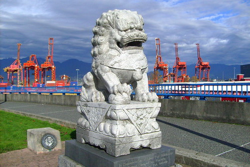 A Granite Lion Presented to Vancouver by Shanghai in 1995 Sits in Front of the Cargo Containers in Port Metro Vancouver