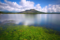 Daylight opera in Batur (tropicaLiving - Jessy Eykendorp) Tags: longexposure morning blue light bali lake motion green nature canon reflections indonesia landscape photography eos volcano daylight asia southeastasia day cloudy outdoor mount crater caldera lee nd filters 1022mm gravel active batur kintamani canon1022mm gnd 50d bigstopper regionwide lee10stopnd