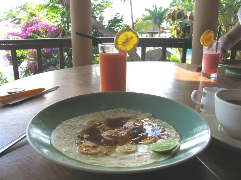 Banana pancake with palm sugar syrup and lime, and guava juice