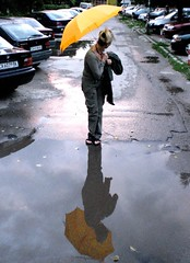 The rain stopped (horstgeorg) Tags: street art rain yellow umbrella reflections puddle sofia bulgaria flickrsbest superhearts