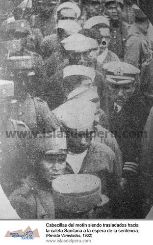 Marineros cabecillas del motín de marinería en el muelle de la Base Naval San Lorenzo, siendo trasladados hacia la caleta Sanitaria para esperar la sentencia de la corte marcial