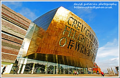 Millennium Centre Architecture - Cardiff Wales Art - quitecture (david gutierrez [ www.davidgutierrez.co.uk ]) Tags: city blue sky urban building art wales architecture buildings spectacular geotagged photography photo arquitectura cityscape image sony centre cymru cardiff cities cityscapes center structure millennium architectural 350 architektur sensational metropolis alpha cardiffbay impressive dt municipality edifice cites milleniumcenter f4556 1118mm canolfanmileniwmcymru sonyalphadt1118mmf4556 quitecture sony350dslra350 millenniumcentrearchitecture