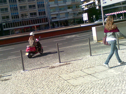 _ she owns a pink vespa and ride a friend to shopping _
