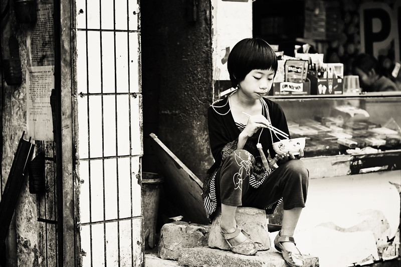 Girl Eating Rice Front BW BLOG