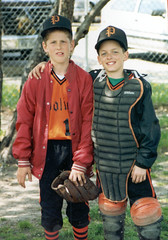Chad and I in little league. I was the pitcher, he was the catcher. What you can't see was our secret weapon: The red baseball spikes (yes, to go along with our orange and black uniforms!)