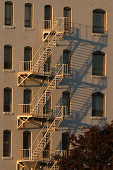 August 20, 2007: Fire Escape and Shadows (plastereddragon) Tags: sunset shadows fireescape commonplaces fitchburg sovereignbank canonef70300mmf456isusm rebelxti fitchburgma
