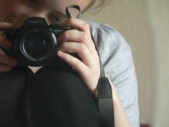 Peek-a-Boo (rhiannonhope) Tags: camera girl smile grey blake curlyhair sooc