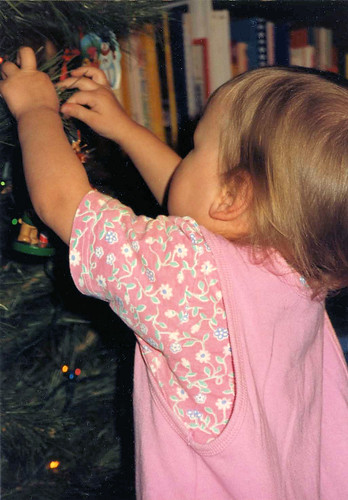 Christina (1½) decorating the Christmas tree, Thanksgiving 1991.