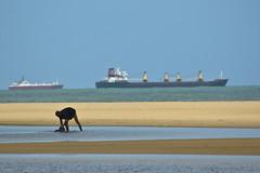 Man on Cotonou beach and ship (fredogaza) Tags: africa beach benin plage afrique cotonou