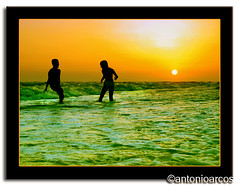 EmeraldLove,SummerScenes &Joy (AntonioArcos aka fotonstudio) Tags: ocean boy sunset orange sun green beach water girl yellow fun bravo huelva silhouettes playa games colores atlantic matalascaas sanse aplusphoto fotonstudio antonioarcos torrelahiguera joyoflove
