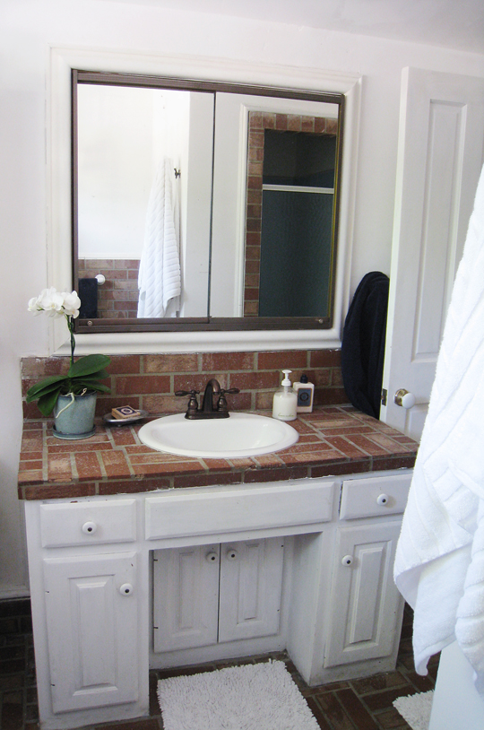 Brick Beach and white Bathroom decorating ideas