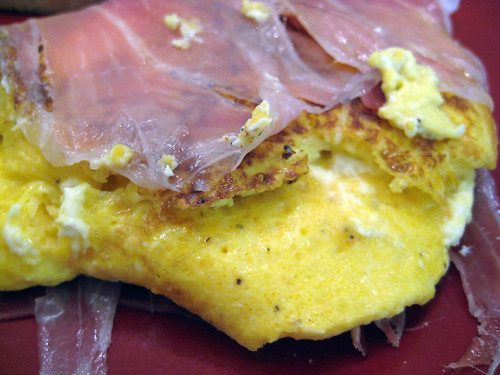 cream cheese scramble with proscuitto on bagel