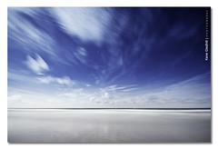 Moon Clouds Of Illusion. ([ Kane ]) Tags: ocean longexposure light moon cold beach water night clouds reflections stars movement sand time space fast sigma australia qld timetravel kane 1020 2009 newyearsday 2010 goldcoast gledhill 50d kanegledhill 1stjan2010 wwwhumanhabitscomau kanegledhillphotography