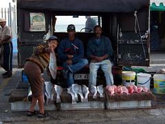 Fisherman offering fish