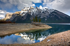 Reflection of splendor (JoLoLog) Tags: mountain lake canada joe alberta rockymountains banffnationalpark lakeminnewanka thecanadianrockies mountinglismaldie fairholmerange canonxsi bestcapturesaoi elitegalleryaoi