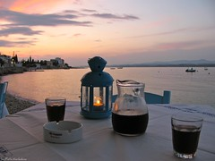 Greek table (Fotis Korkokios) Tags: sunset summer beach dinner restaurant candle wine greece tavern greekdinner bluesea spetses greekisland  greekway fostis
