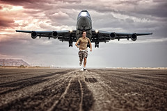 Run poet run.... (ADIDA FALLEN ANGEL) Tags: road street clouds danger composition photoshop plane israel airport nikon friend funny horizon fear border running run landing explore morbid poet frontpage runway d40