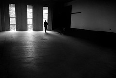 Calling (Carlos Ebert) Tags: windows bw composition space empty cellphone calling saloon emptyness againstthewindow