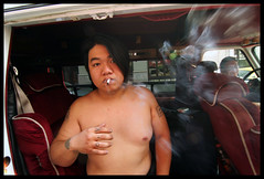 (* raymond) Tags: street nyc red newyork lens cigarette smoke velvet tattoos dude flare chip van 2007 worldphotodoc2007