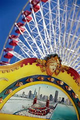 "Chicago - Navy Pier ""Carosel Artwork & Ferris Wheel"" (David Paul Ohmer) Tags: pictures park city travel carnival chicago art tourism photography amusement pier illinois nikon downtown waterfront ride photos pics navy cities windy swing adventure entertainment ferriswheel navypier carosel nikkor n90 thrill cookcounty chicagoland 28200mm travelphotography cityphotography"