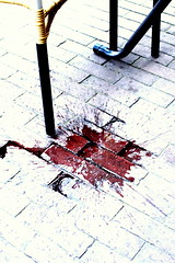 angry man spills wine on street - by Marco Raaphorst