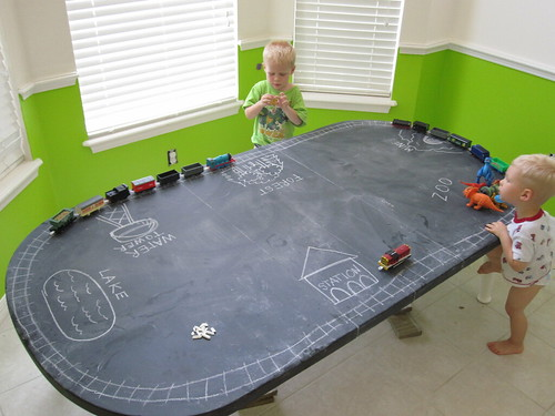 Playing on the Chalkboard Table in the Playroom
