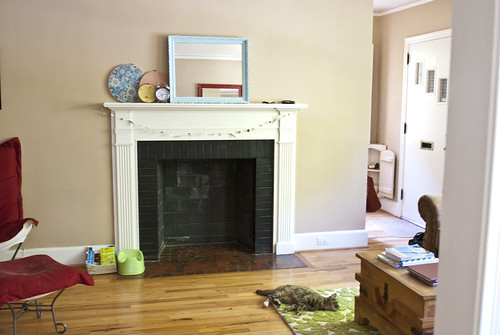 living room with potty and book basket