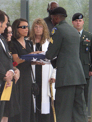 Salette Latas receives the American flag at Jesse's funeral.