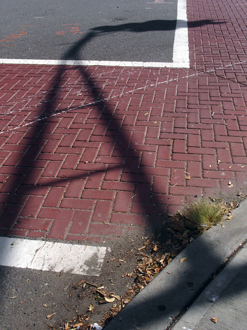 brick crosswalk and shadow