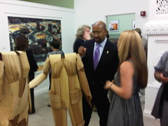 Mayor Nutter speaking with an artist at the opening reception for The Art Gallery At City Hall