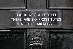 This is not a brothel... (Tom Coates) Tags: door white black text symmetry signage prostitutes brothel takingastand meardstreet thisisnotabrothel