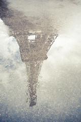 Reflecting Paris (Oscar Bjarna) Tags: travel paris france reflection tower wet water pool rain puddle drops oscar tour eiffel drop reflect bjarnason canon5dmkii analogsystm