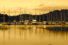 tarbert harbour (Glenn 07) Tags: trees sea sky sepia clouds canon reflections boats harbor scotland dock shadows harbour 7d bouys tarbert 18200mm flickraward glennfosterportfolio