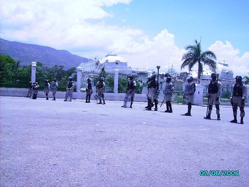 Soldiers guarding the destroyed Presidential Palace