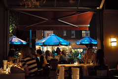 Summer in Montreal (caribb) Tags: city people urban food canada restaurant downtown montral quebec eating montreal patio qubec relaxation umbrellas centrum metropolitan sophisticated enjoyment ville centreville terasse bustling anightout monklandtavern tavernedemonkland
