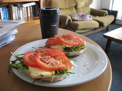 Poppy seed bagel with haloumi, tomato and rocket