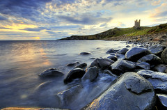 Dunstanburgh Castle (Corica) Tags: uk greatbritain sea england sky castle water clouds sunrise landscape rocks northumberland northsea craster dunstanburgh dunstanburghcastle corica rumblechurn