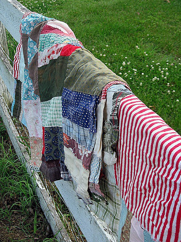 Old quilt scraps- stains and all