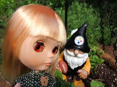 Lemon and the Steelers gnome in Mom's garden.