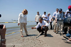 President Obama with beach tar from the Oil Spill