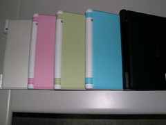 white green pink blue black laptops