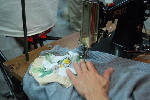 Karin, sewing a fabric piece