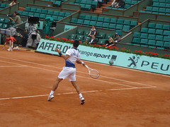 Tennisman en action