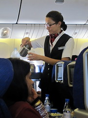 A Stewardess....;) () Tags: pakistan vacation woman india holiday coffee girl fruit breakfast plane airplane glasses fly inflight cafe uniform sitting aircraft flight jet aerial garota mulheres ba boeing pk frau punjab stewardess britishairways 777 mujeres fille rtw caff aereo airliner vacanze avion caf roundtheworld flightattendants flightattendant globetrotter boeing777 oneworld areo airhostess cabincrew republicofindia azafata airplaneseats insidetheplane worldtraveler kahwa airlineseats  cabininterior stewardesse   interiorcabin 33h ba256   inthecabin pkistn seat33h flight256 stiwardes