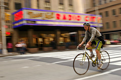 Cycling in Manhattan (Rafal Bergman) Tags: street new york city nyc music usa ny man bike bicycle radio cycling hall d70 manhattan aplusphoto
